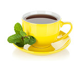 Yellow tea cup with mint