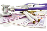 Cigarettes and stethoscope on Euro money