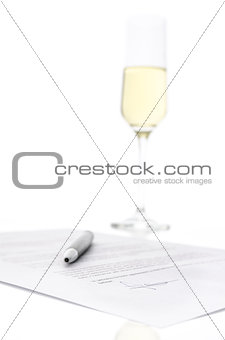 Contract and a glass of champagne