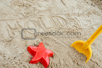 Holidays written in sand