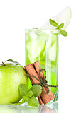 Green cocktail with apples, mint and cinnamon