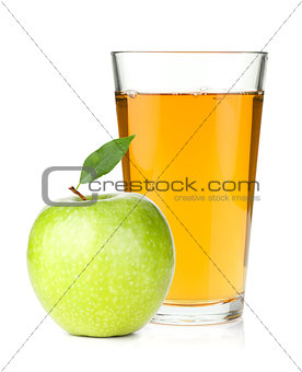 Apple juice in a glass and green apple