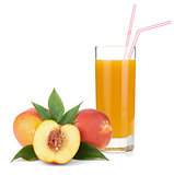 Peach juice in a glass and fresh peaches