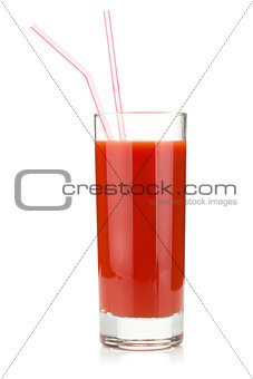 Tomato juice in glass with two drinking straws