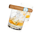 Two whiskey glasses and cigar