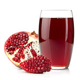 Pomegranate juice in a glass and ripe pomegranate