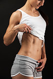 Young fitness woman over black