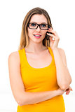 woman in glasses talks by mobile phone