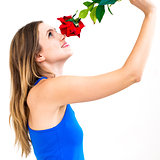 woman with a flower and thinking about love