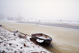 boat on frozen canal in Netherlands