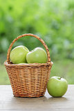 green apples in a wicker basket