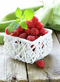 ripe fresh organic raspberries in the basket