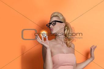 blonde girl kissing light bulb