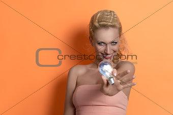 blonde girl showing light bulb