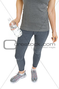 Closeup on fitness young woman with bottle of water