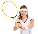 Smiling tennis player showing racket