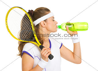 Female tennis player drinking water