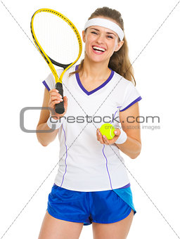 Portrait of smiling female tennis player with racket and ball