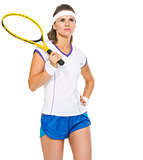 Portrait of confident female tennis player