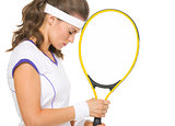 Portrait of stressed female tennis player