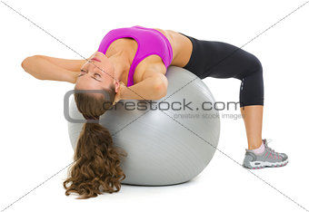 Fitness young woman doing abdominal crunch on fitness ball