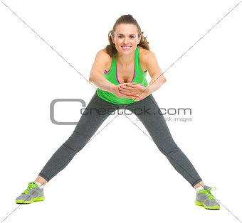 Happy fitness young woman stretching