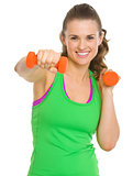Happy fitness young woman workout with dumbbells