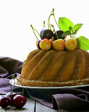 round sponge cake with berries cherry