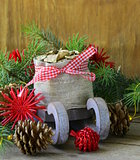 Christmas composition - a wooden sleigh with gifts and fir tree  branches