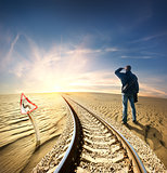 Man and railway in desert