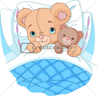 Cute baby bear in bed