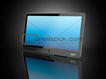 Black tablet pc on black background