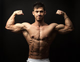 Portrait of muscular man flexing his biceps