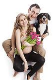 Pregnant couple and Entlebucher Sennenhund dog