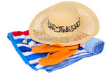 straw hat and beach towel