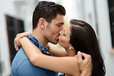 Young couple kissing in the street