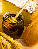 Healthy jar of honey with bakery products