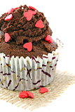 Chocolate Cupcake with red hearts.