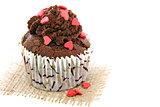 Cupcake with sugar hearts.