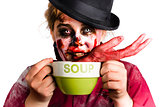 Zombie woman eating hand soup