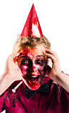 Woman with horror make up and party hat