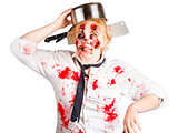 Zombie woman with cooking pan on her head
