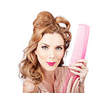 Cute retro female hairdresser with big hair comb