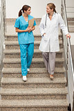 Health specialists going down the stairs