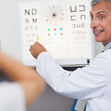 Doctor smiling while doing an eye test on a patient in a hospital