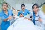 Team of doctor running in a hospital hallway