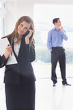 Woman calling while man looking around and deciding