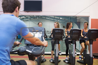 Happy women at spinning class