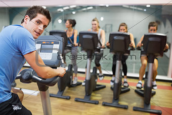 Male instructor at spinning class