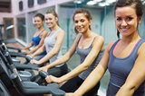 Smiling women at spinning class